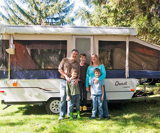 family by their camper