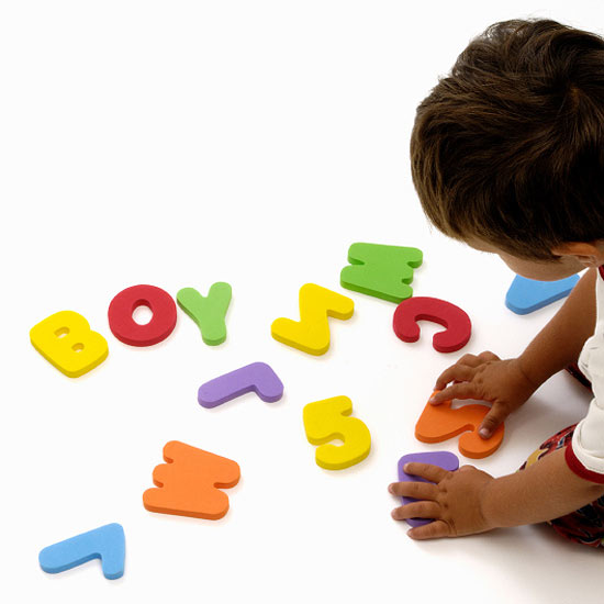 boy playing with letters