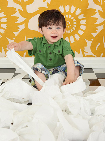 Child playing with toilet paper