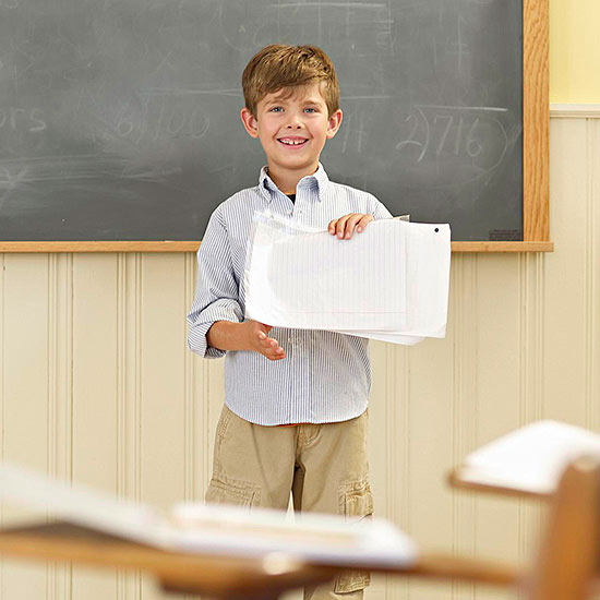 Boy giving presentation in class