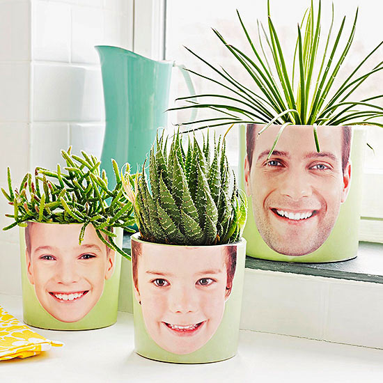 3 plant pots with faces