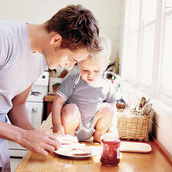 Dad making sandwich with kid