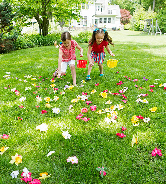 Girls on grass with flowers