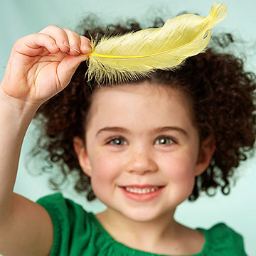 Child Blowing Feather