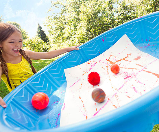 Alt Text Girl holding pool with paper and four balls inside
