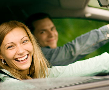 couple driving car