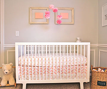 White crib with pink bedding