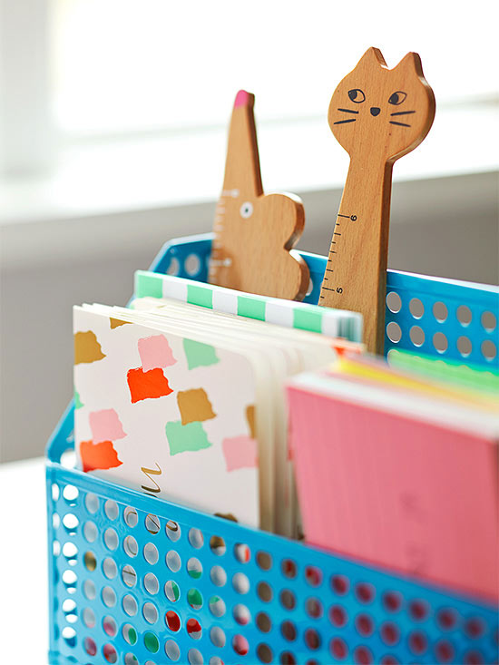 Wooden cat and mouse sticking out of blue file holder