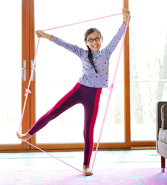 Girl making trapezoid with stretchy band