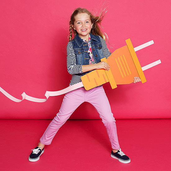 Girl holding giant faux electrical plug