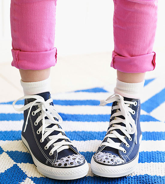 Googly eyes on toes of Converse sneakers