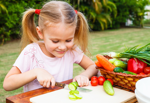 Girl cutting veggies