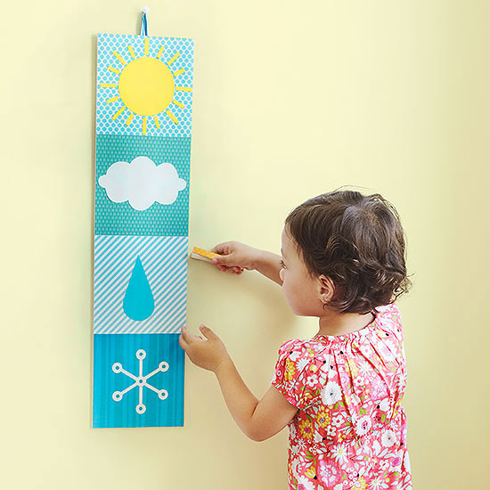 Girl holding clothespin to weather craft