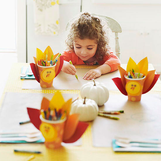 Girl at table with Crayon Caddies