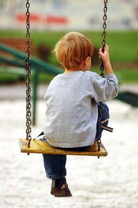 Child on a swing 33573