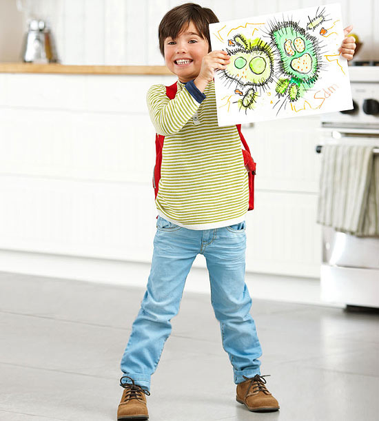 child holding drawing of germs