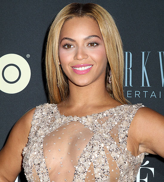 Beyonce smiling in pretty dress