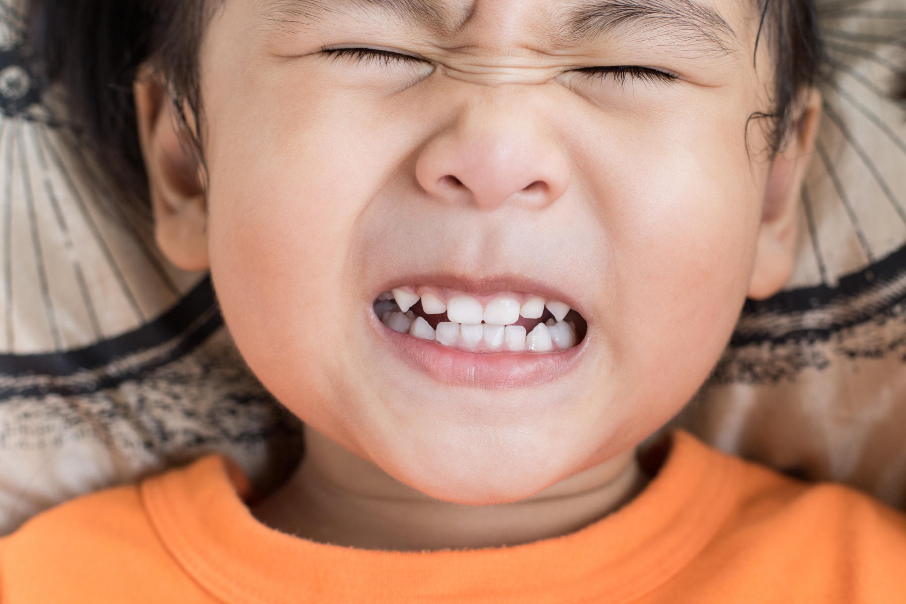young boy showing his teeth and making a funny face