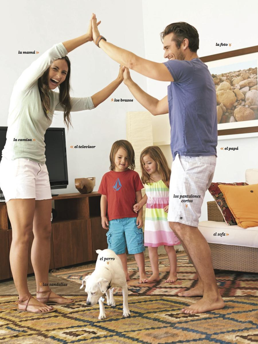 parents and children dancing in living room