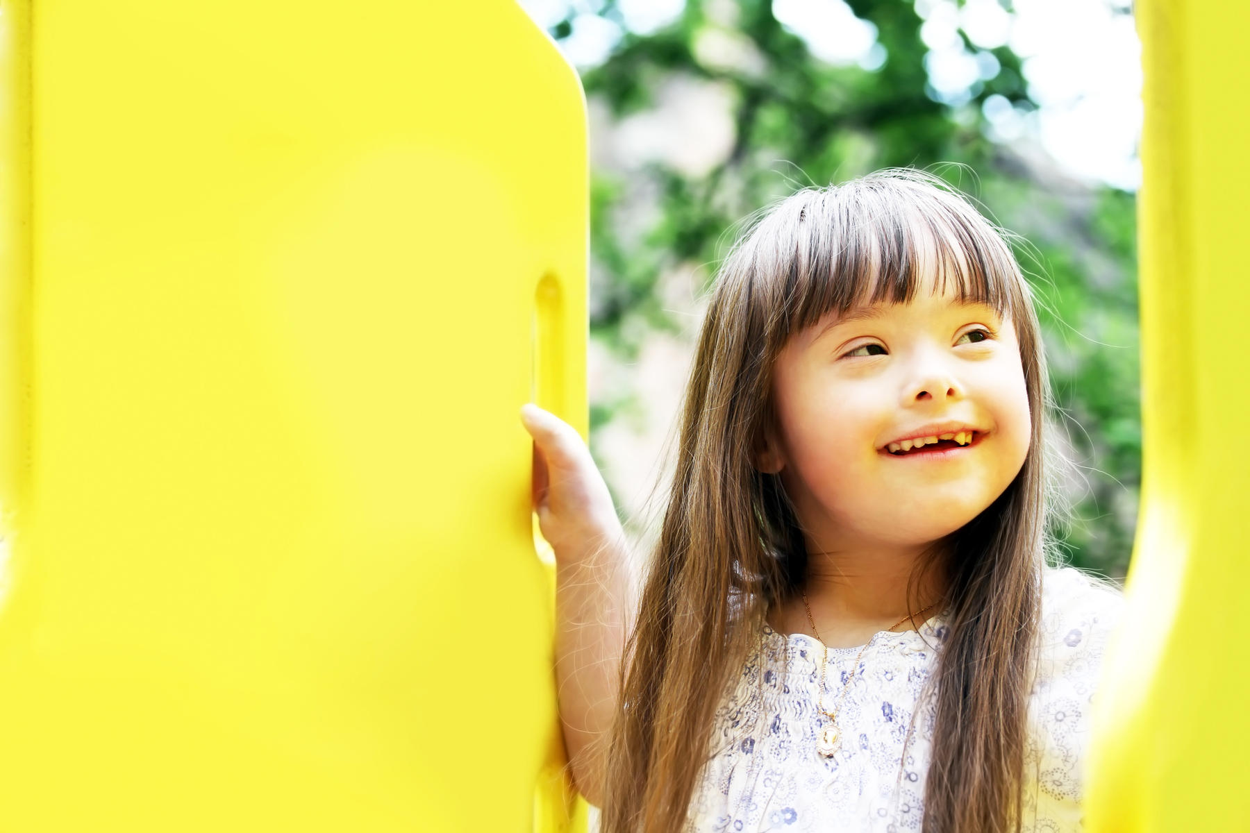 smiling young girl with down syndrome