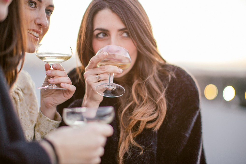 women drinking alcohol at party