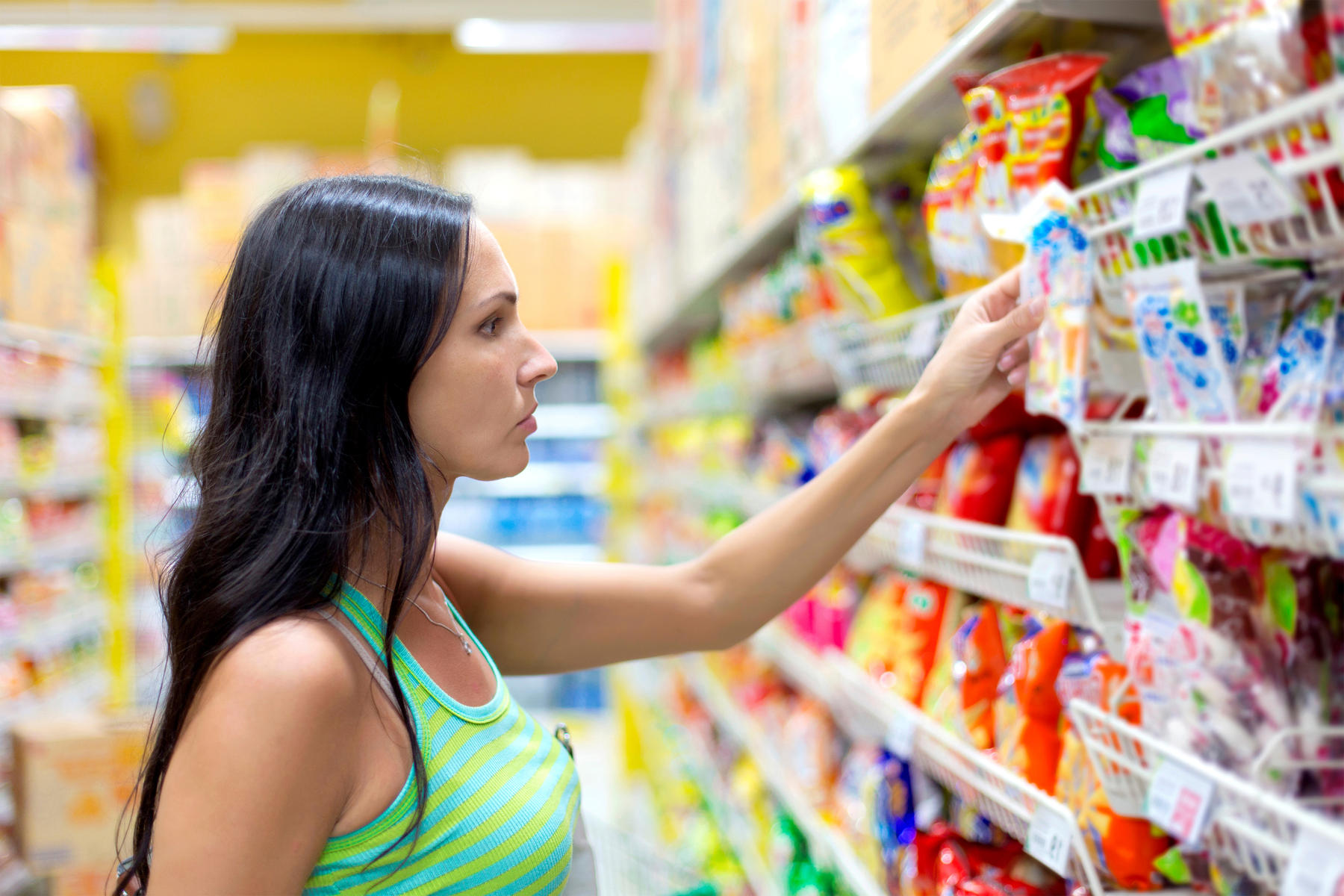 Woman at Grocery Story Looking at Food Label
