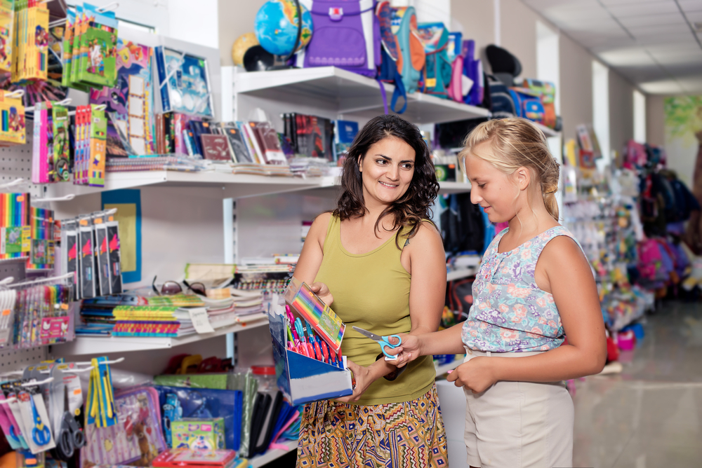 mom and daughter shopping for school supplies
