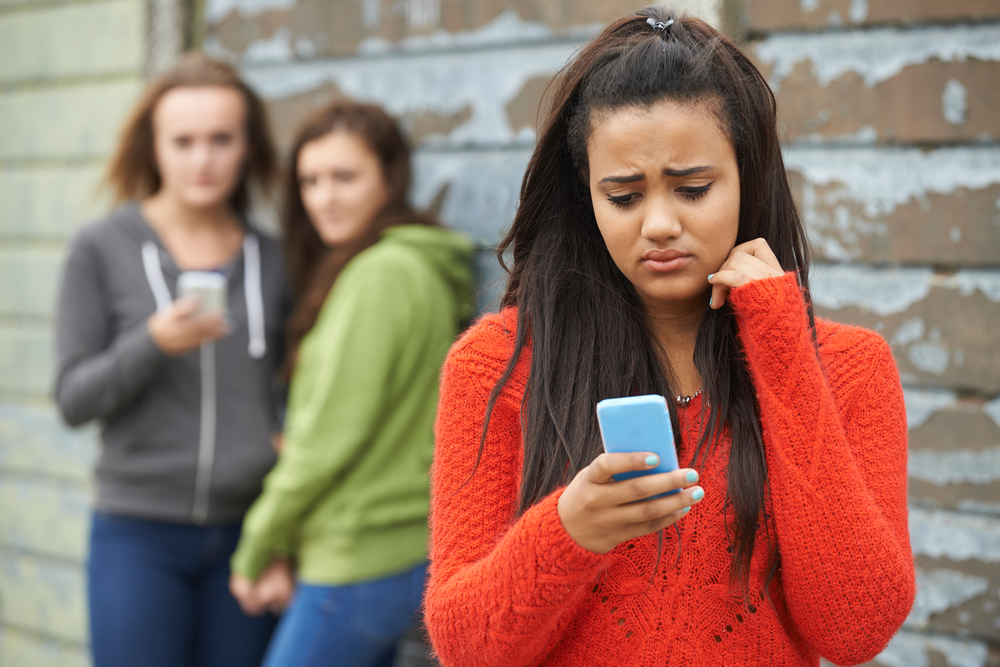 girl being bullied and texting