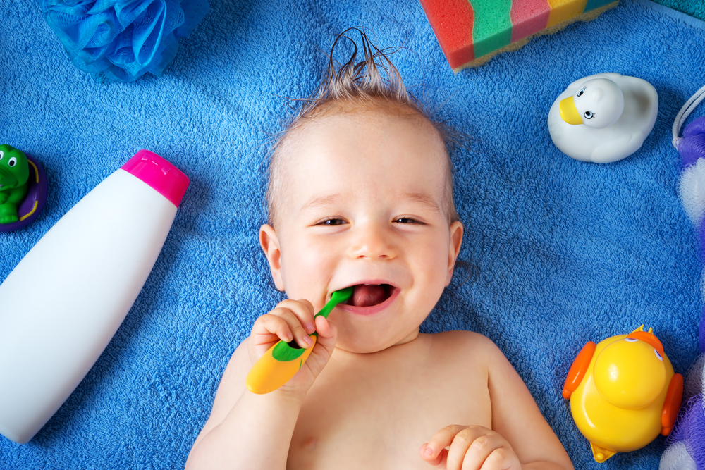 Baby Teeth Myths Boy Brushing Teeth Blue Towel