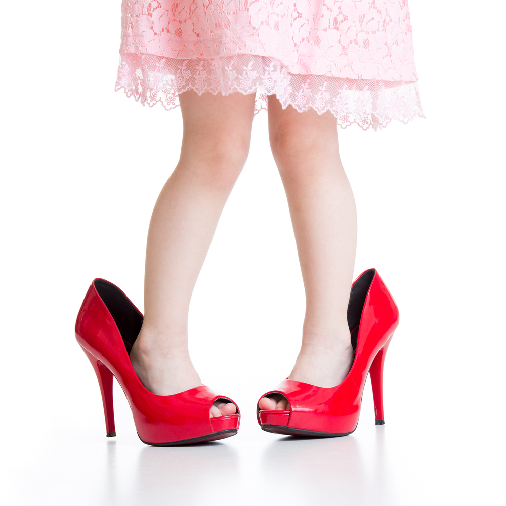 little girl in red high heels