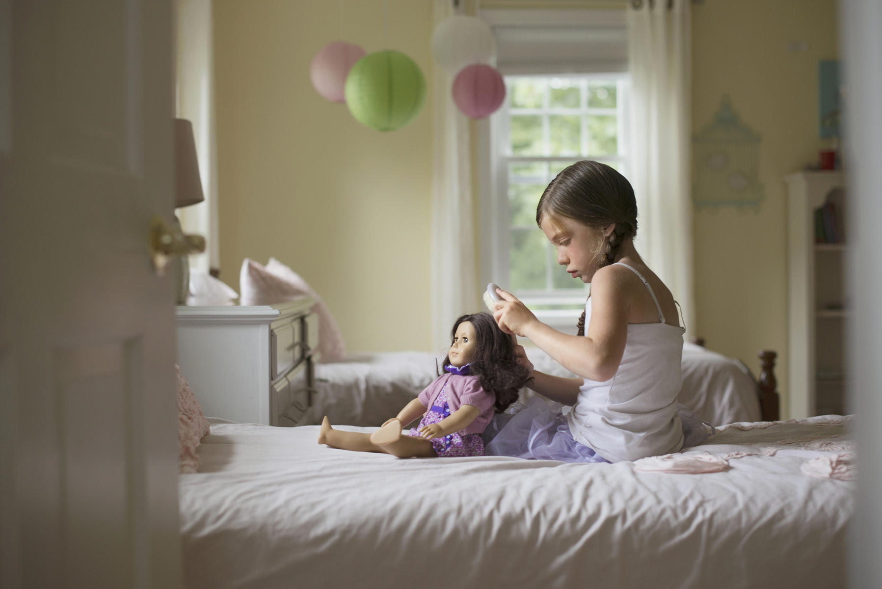 Girl playing with American Girl Doll