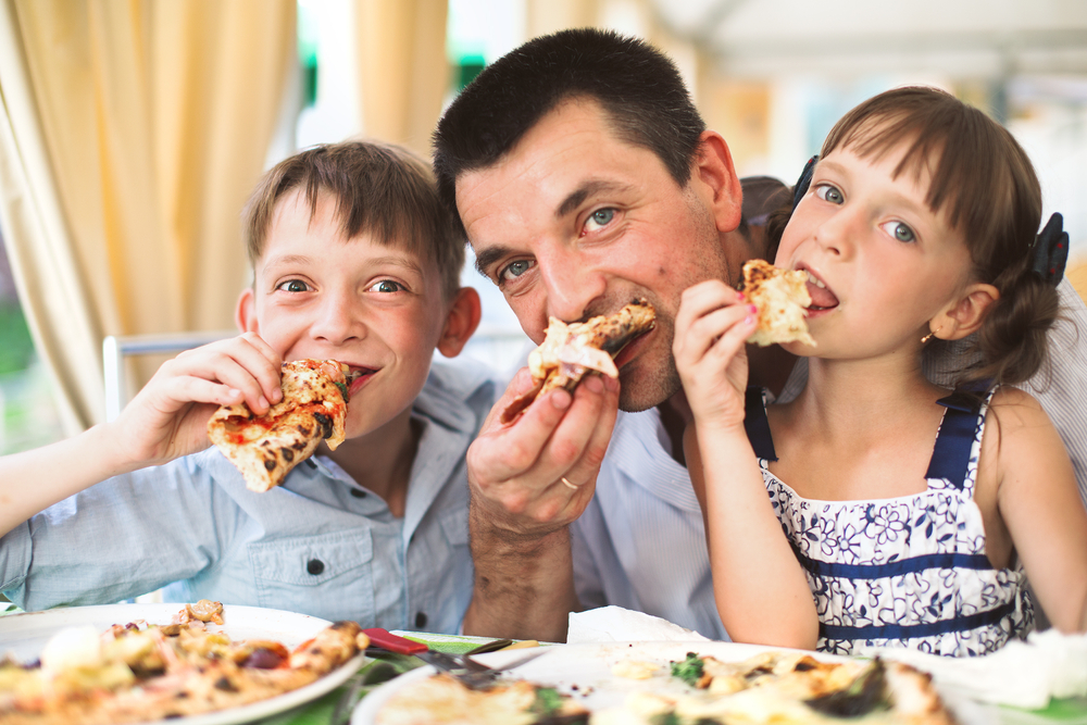 dad and kids eating unhealthy food