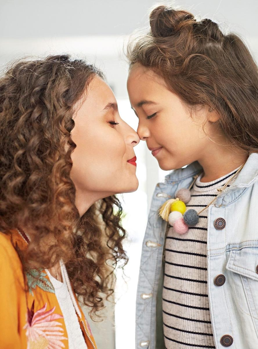 Mother and Daughter Nose Touch