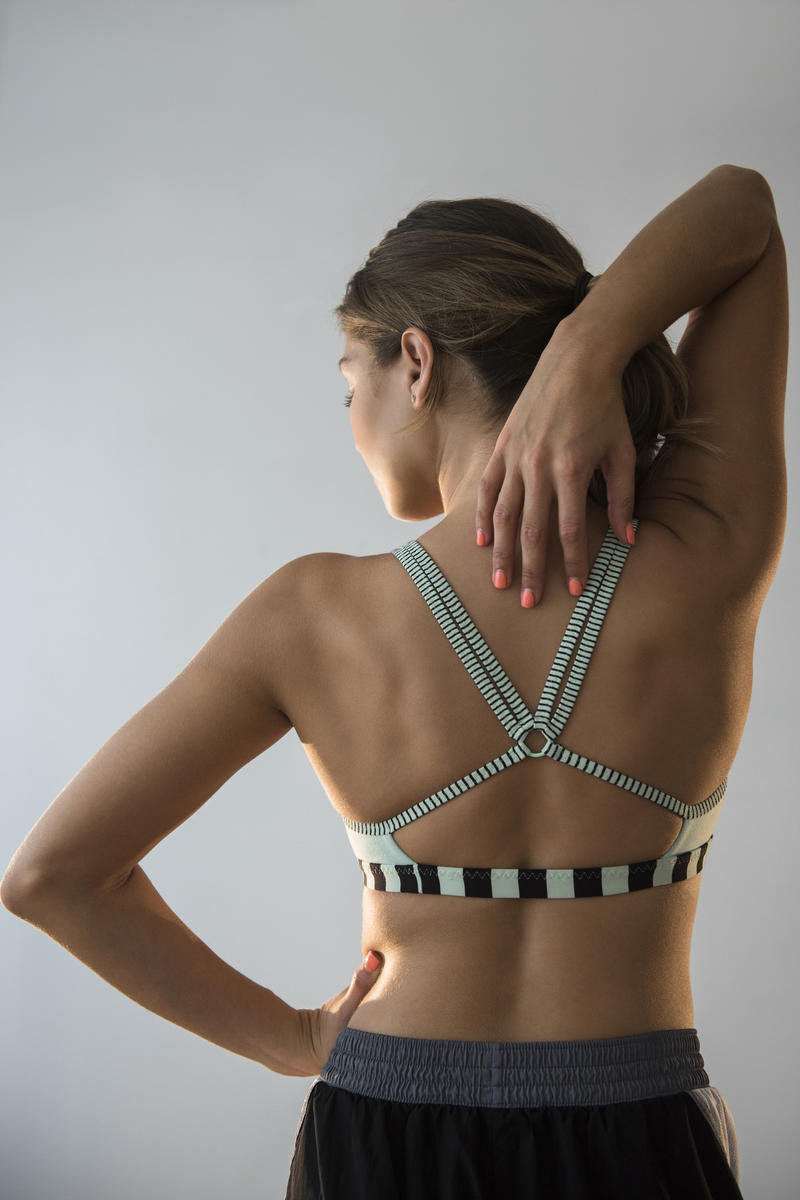 woman stretching arms and back muscles