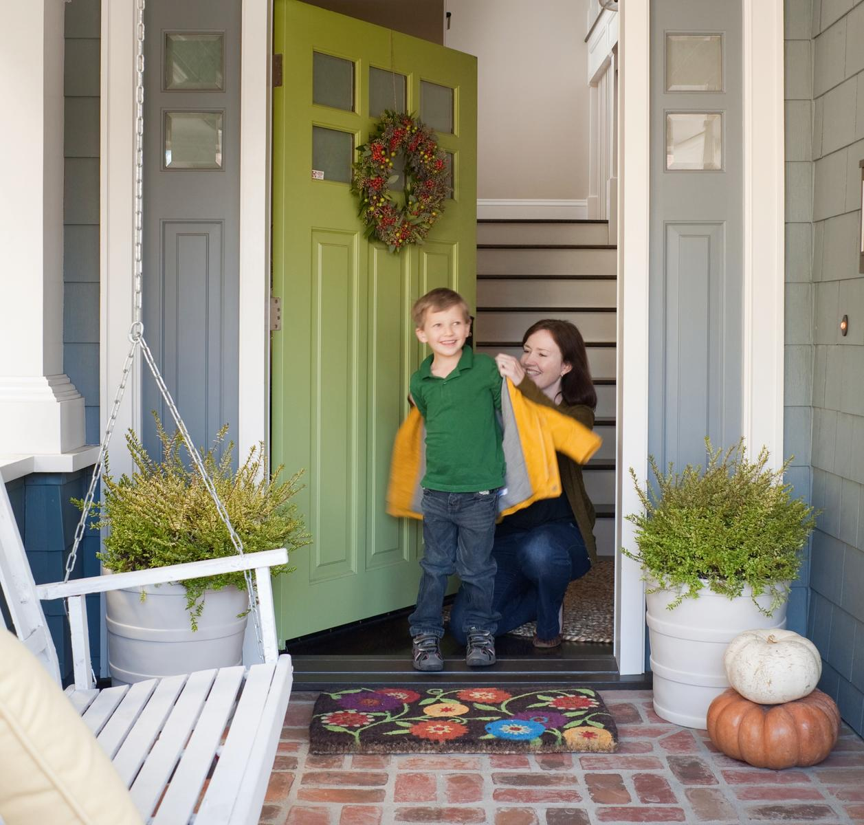 Mom Putting Jacket On Son Walking Out The Door