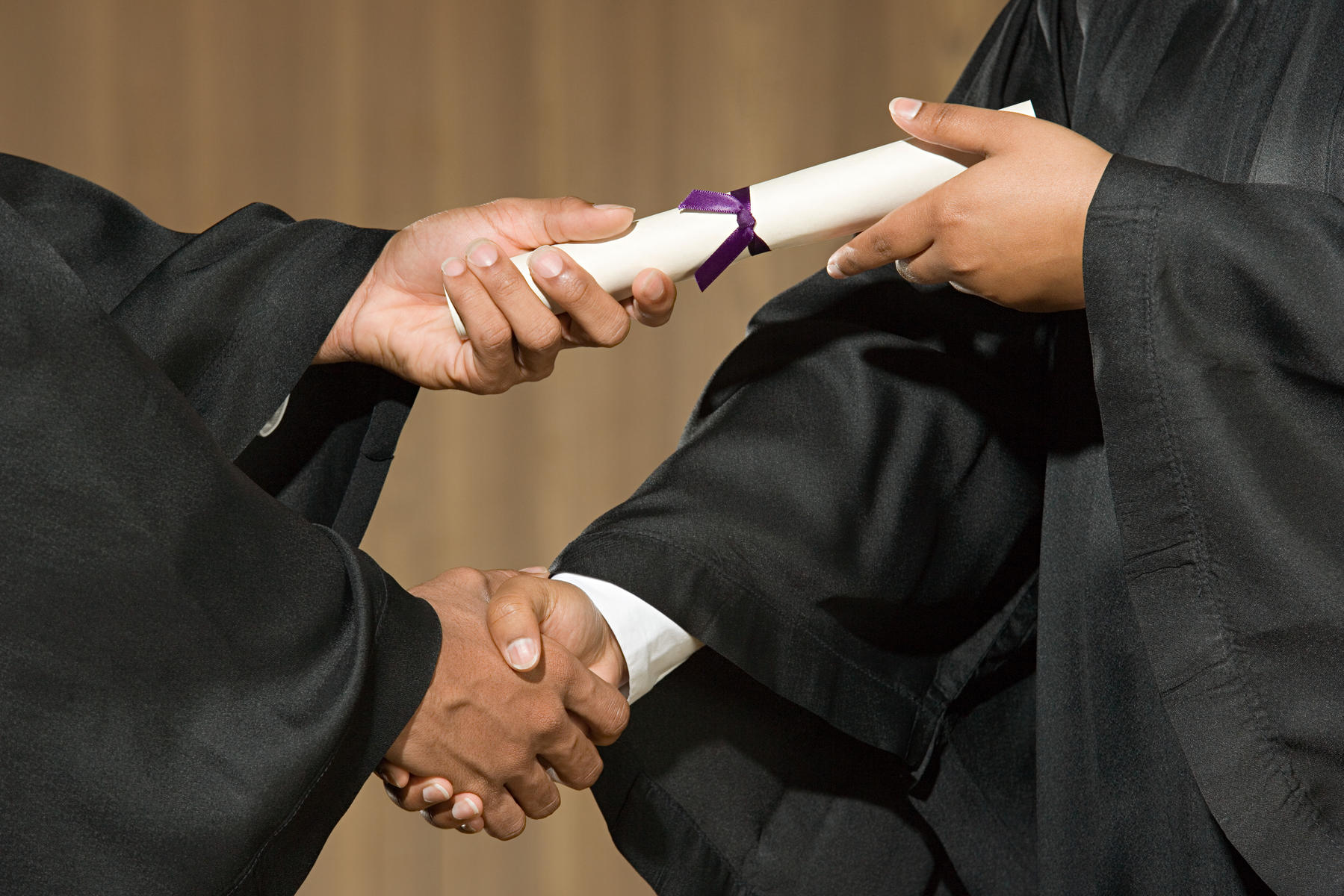 Student Receiving Diploma Shaking Hand