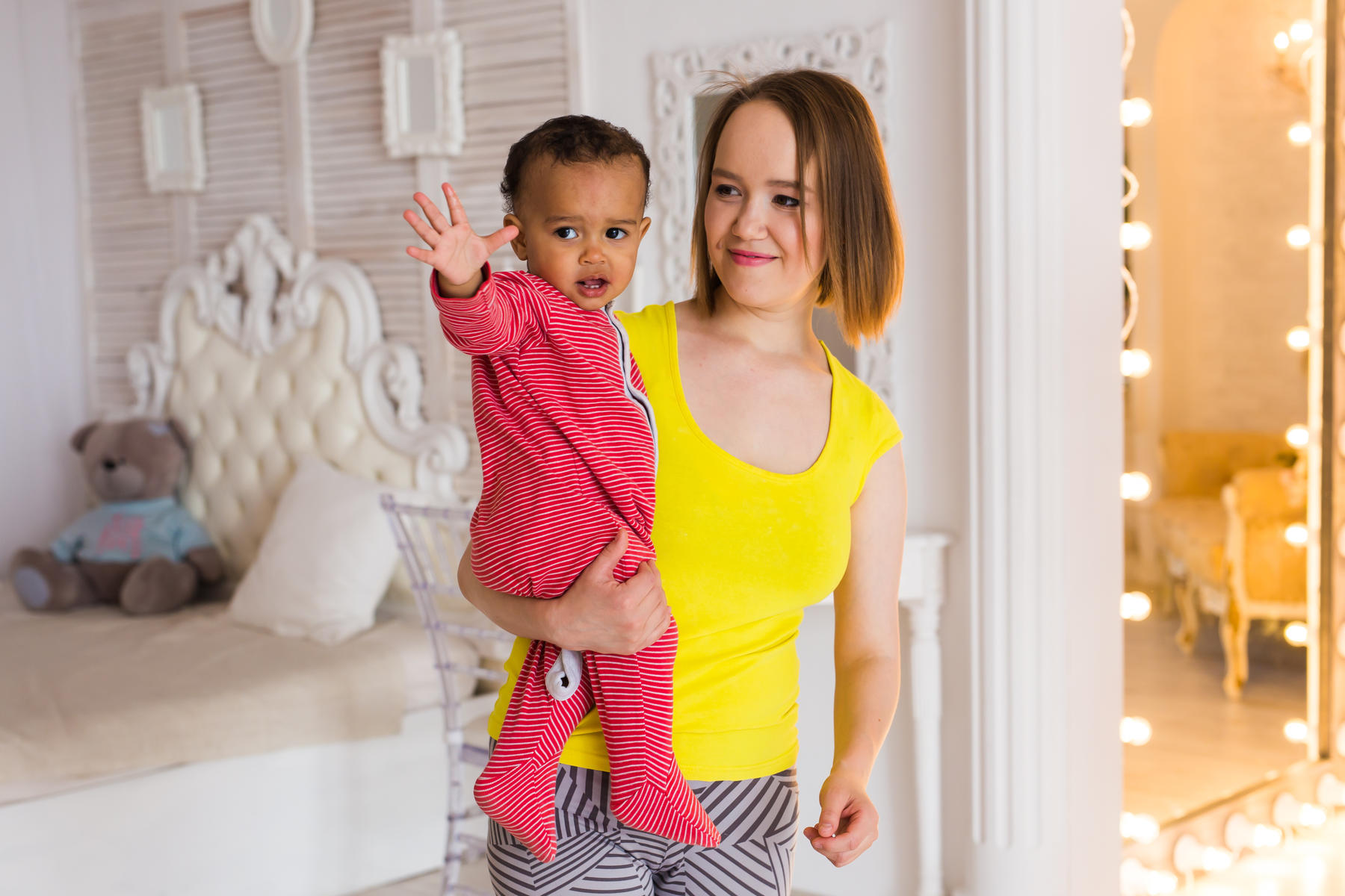Mother Holding Mixed Race Baby Son At Home