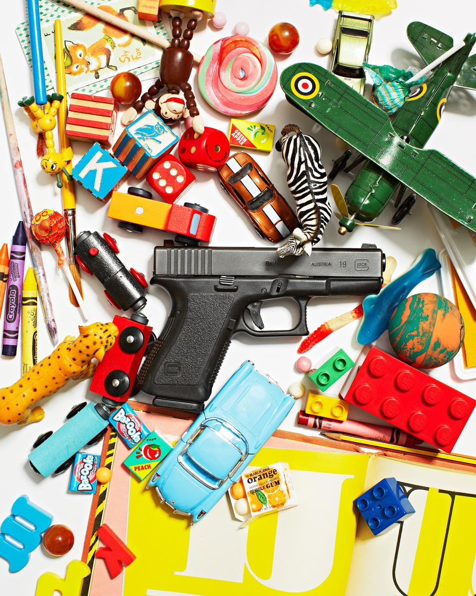 Gun On Table With Toys and Candy