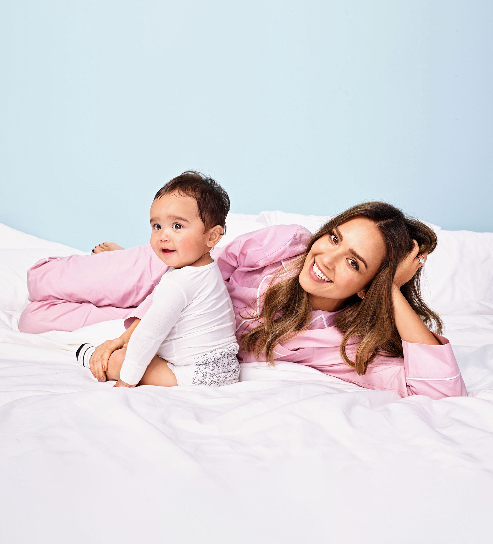 jessica alba and son in pajamas on bed