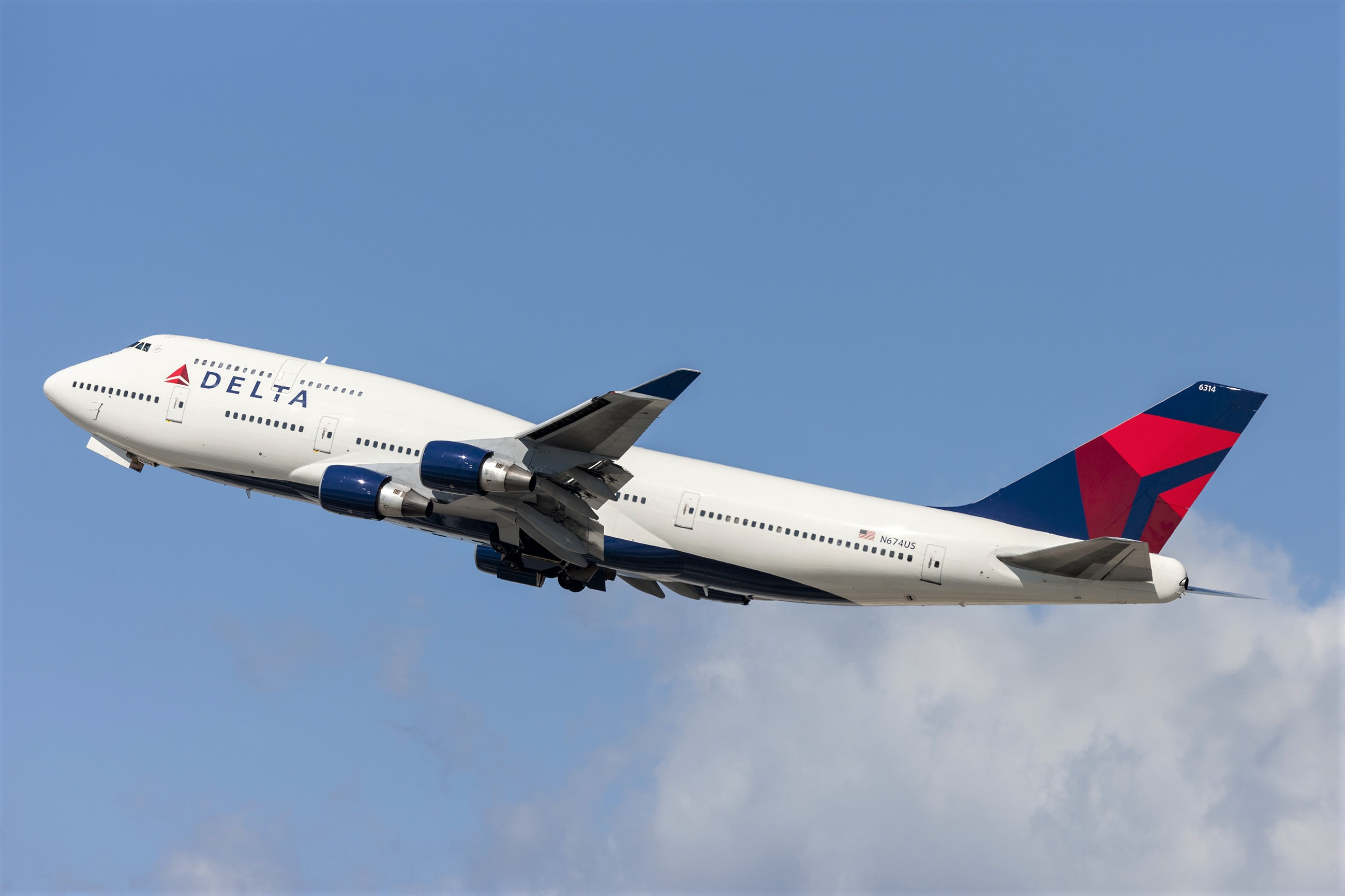 Delta Airplane Flying In Sky