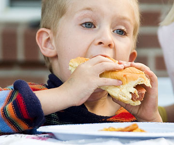boy eating hot dogs