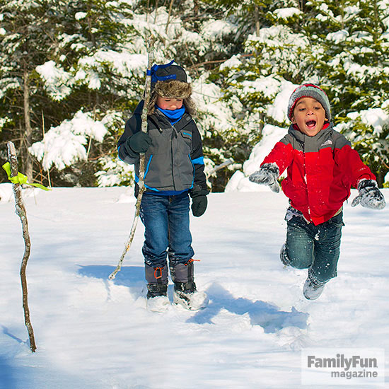 Two kids jumping in the snow