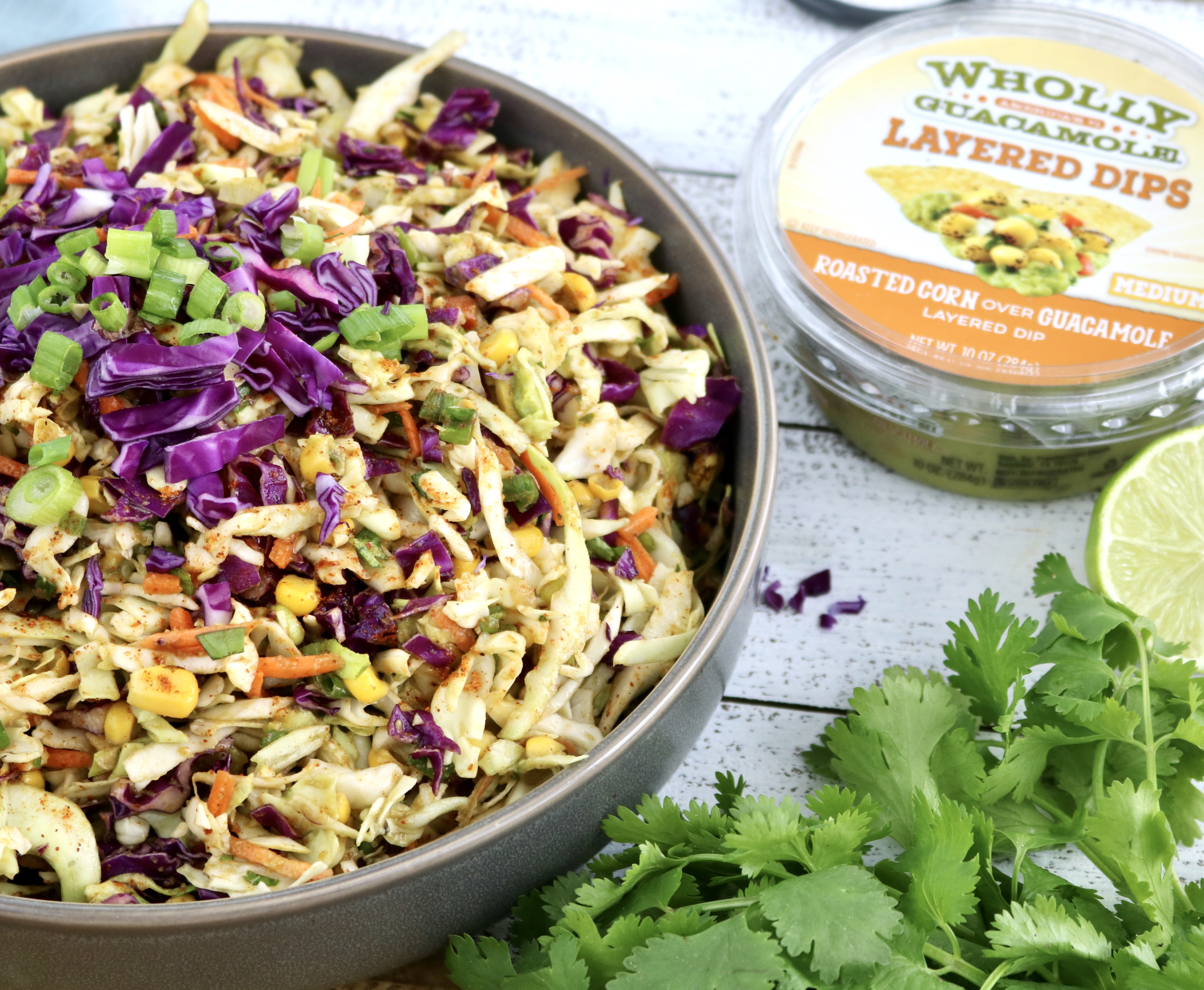 The perfect addition to any picnic is as easy as mixing coleslaw mix with Wholly Guacamole Dip made with real avocados.