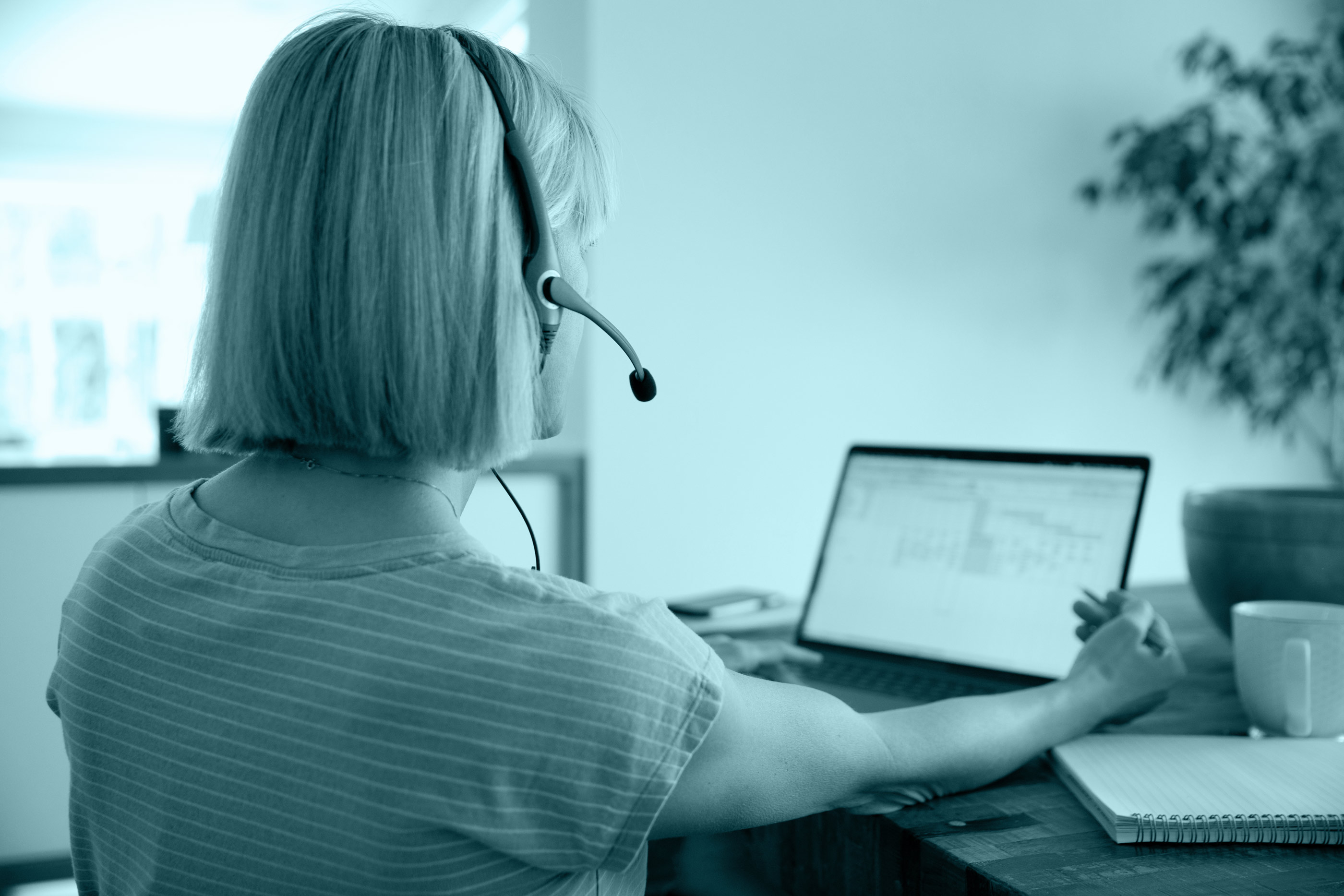woman on headset at home