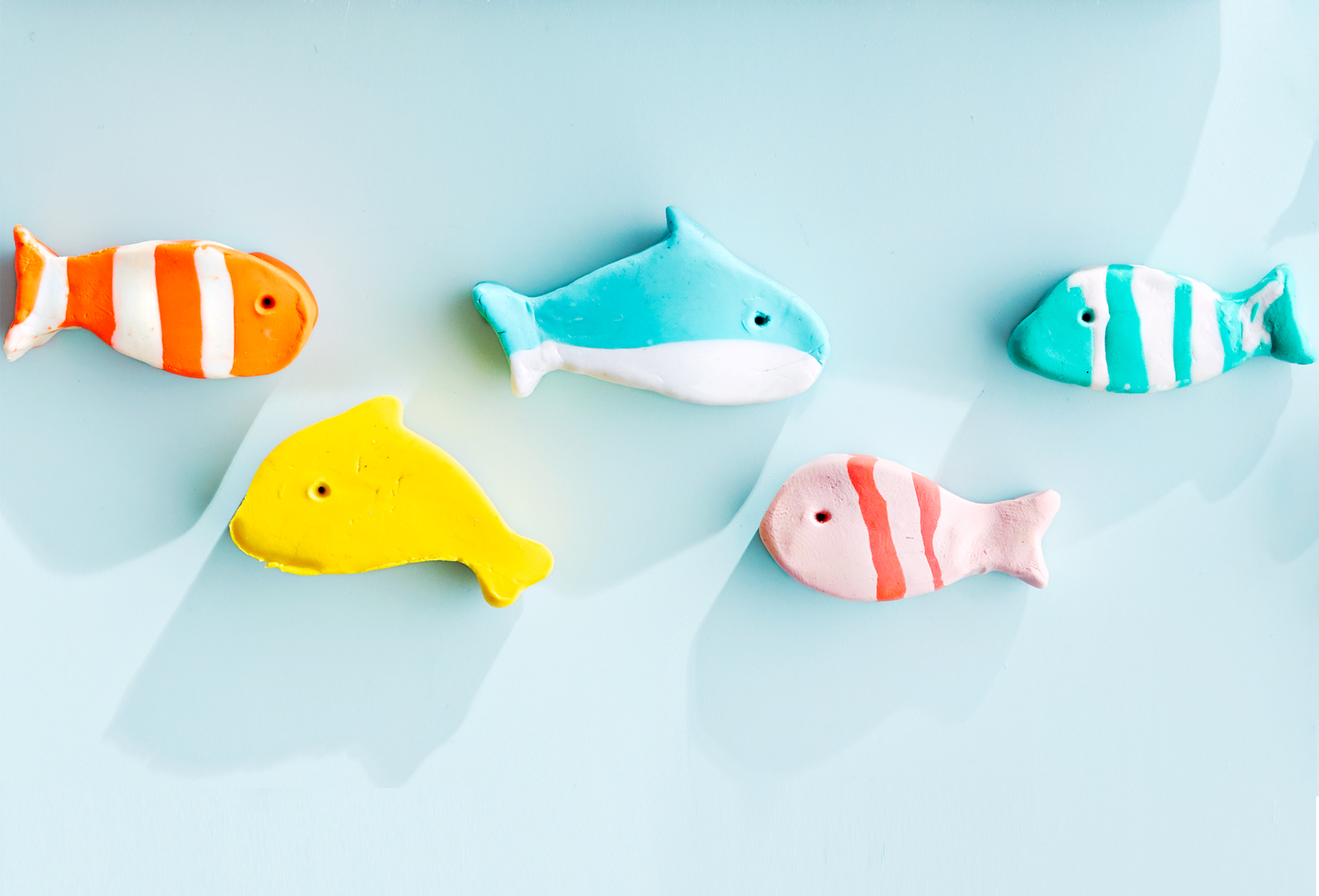 fishie erasers on blue background
