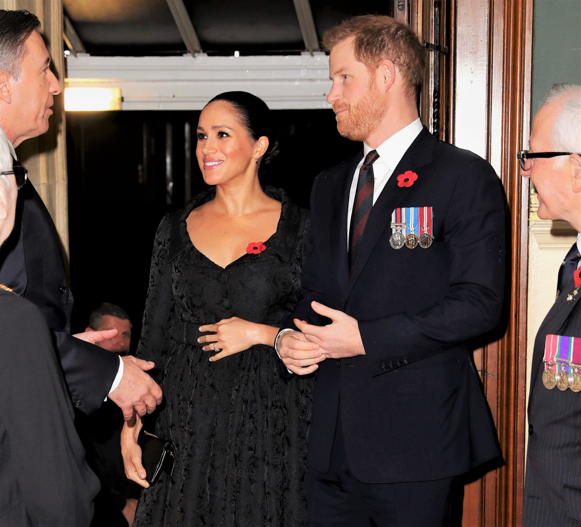 Meghan Markle Hand Over Belly and Prince Harry at the Royal British Legion Festival of Remembrance at the Royal Albert Hall