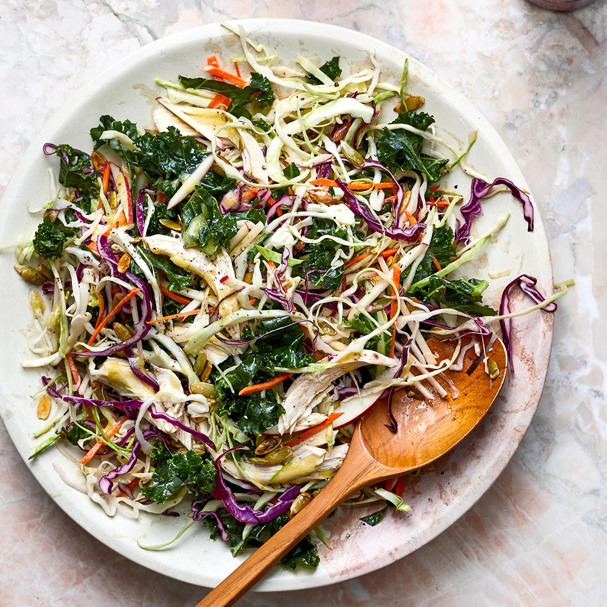 apple-chicken slaw and spoon