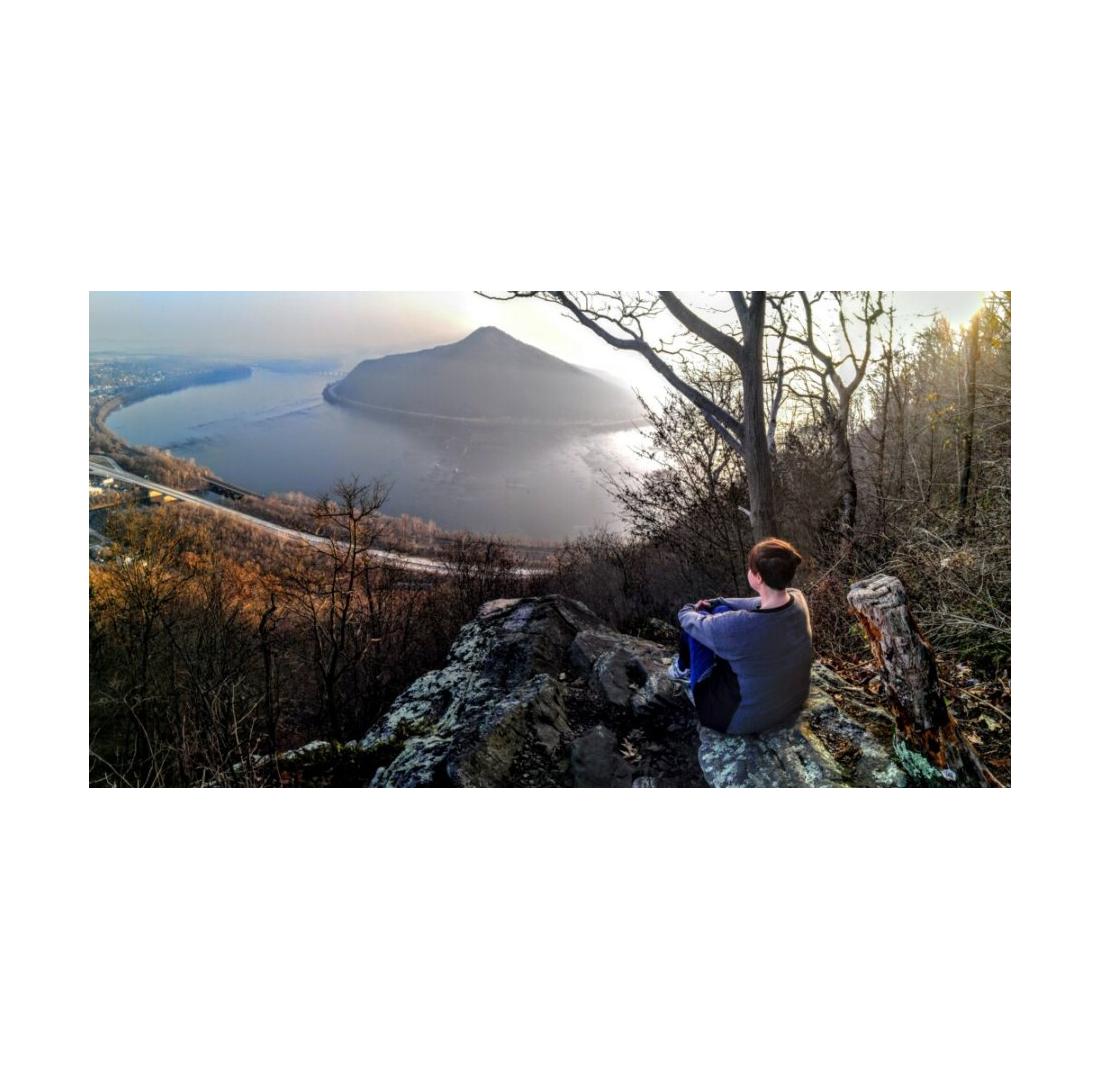 Debby Michael sitting on mountain