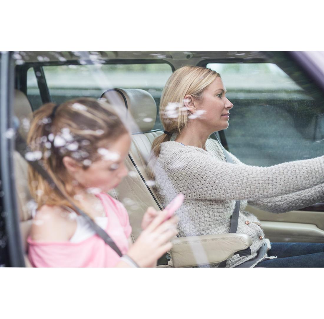 Mom driving her children around