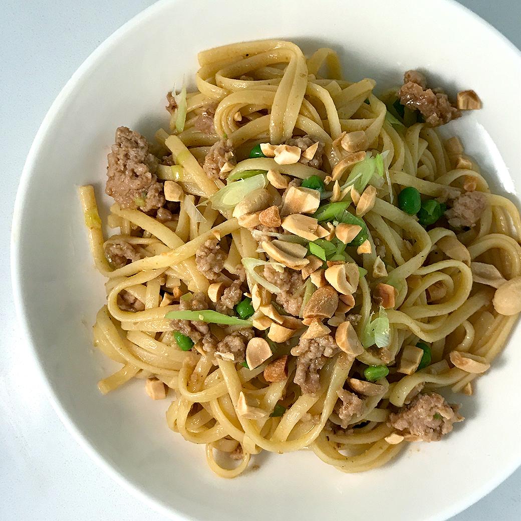 bowl of peanut noodles with pork